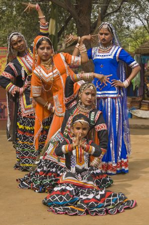 Group of Kalbelia tribal dancers performing at the annual Sarujkund Fair near Delhi, India photo
