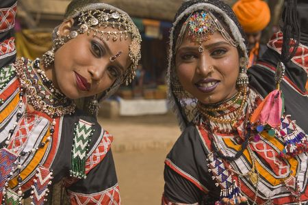 Beautiful Kalbelia dancers in ornate black costumes trimmed with beads and sequins at the annual Sarujkund Fair near Delhi, India. photo