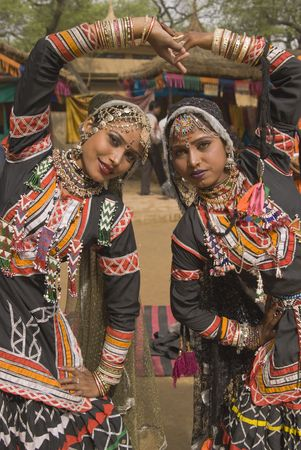 Beautiful Kalbelia dancers in ornate black costumes trimmed with beads and sequins at the annual Sarujkund Fair near Delhi, India. Zdjęcie Seryjne