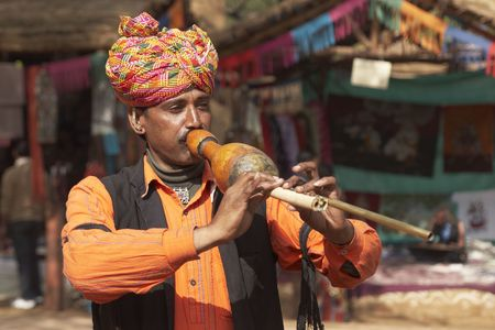 sarujkund: Tribal musician dancers performing at the annual Sarujkund Fair near Delhi, India