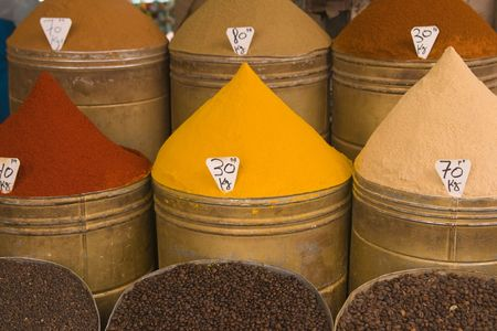 Containers of spices for sale in a shop in the historic heart of Marrakesh, Morocco photo