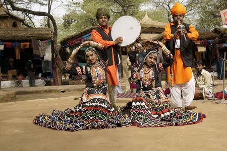Delhi, India - February 12, 2009: Tribal dancers and musician at the Sarujkund Fair near Delhi, India Editorial