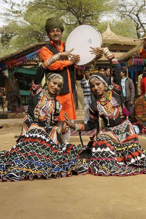 Delhi, India - February 12, 2009: Tribal dancers and musician at the Sarujkund Fair near Delhi, India