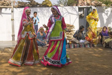 Jaipur, India - March 9, 2009: Beautiful tribal dancers in colorful costume performing in Jaipur, Rajasthan, India