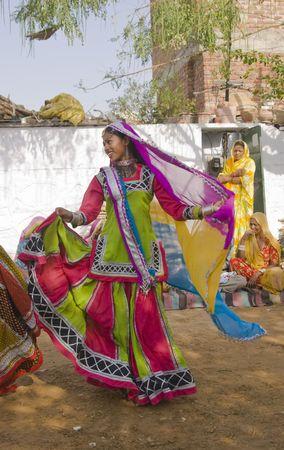 kalbelia: Jaipur, India - March 9, 2009: Beautiful tribal dancer in colorful costume performing in Jaipur, Rajasthan, India