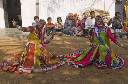 kalbelia: Jaipur, India - March 9, 2009: Beautiful tribal dancers in colorful costume performing in Jaipur, Rajasthan, India