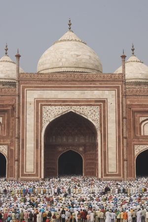 Agra, India - October 2, 2008: Thousands of people gather in front of the mosque at the Taj Mahal to celebrate the Muslim festival of Eid ul-Fitr in Agra, Uttar Pradesh, India