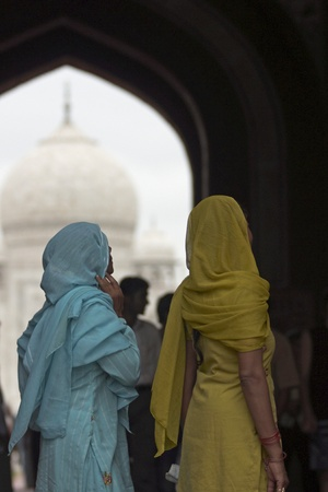 uttar: Agra, India - July 26, 2008: Indian ladies in colorful saris at the entrance to the Taj Mahal in Agra Uttar Pradesh India.