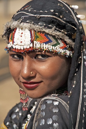 haryana: Haryana, India - February 15, 2007: Indian lady dancing in traditional dress of a Rajasthani gypsy