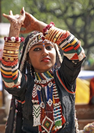 Haryana, India - February 15, 2007: Indian lady dancing in traditional dress of a Rajasthani gypsy