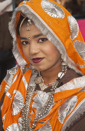 sarujkund: Haryana, India - February 15, 2007: Indian lady in tribal dress at the Surajkund Fair in Haryana near Delhi, India