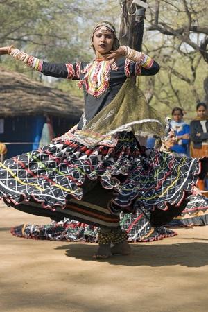 haryana: Haryana, India - February 11, 2008: Indian  Indian lady dancing (movement)