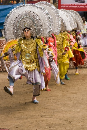 headdresses: Haryana, India - February 3, 2008: Indian dancers in elaborate costume and mask performing Editorial