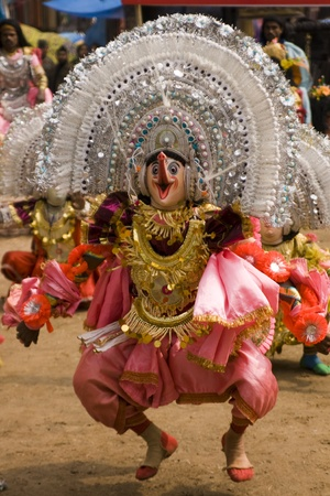 Haryana, India - February 3, 2008: Indian dancer in elaborate costume and mask performing Stock Photo - 8461493