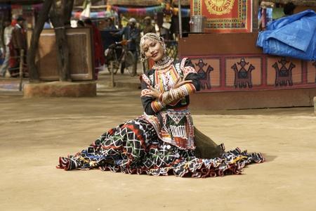 Delhi, India - February 13, 2009: Female tribal dancer performing at Sarujkund Fair near Delhi, India