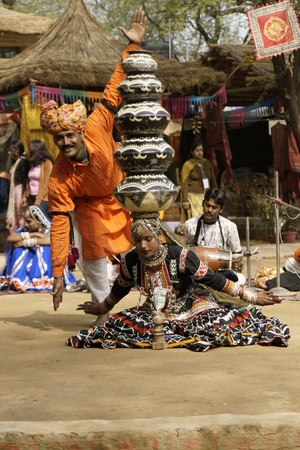 sarujkund: Delhi, India - February 13, 2009: Tribal dancers performing at Sarujkund Fair near Delhi, India Editorial