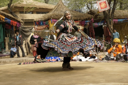 sarujkund: Delhi, India - February 13, 2009: Female tribal dancer performing at Sarujkund Fair near Delhi, India