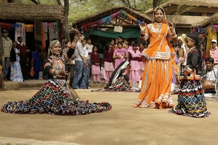 Delhi, India - February 13, 2009: Tribal dancers performing at Sarujkund Fair near Delhi, India Editorial