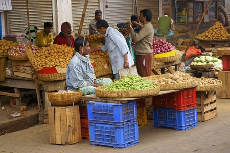 Calcutta, India - December 18, 2008: People selling fruits and vegetables at a street market in Kolkata West Bengal India.  Stock Photo - 8465062