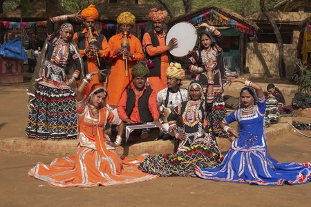 sarujkund: Delhi, India - February 13, 2009: Tribal dancers and musicians at the Sarujkund Fair, Delhi, India