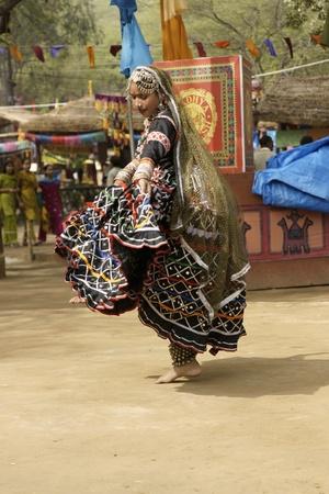 kalbelia: Delhi, India - February 13, 2009: Tribal dancer at the Sarujkund Fair near Delhi, India