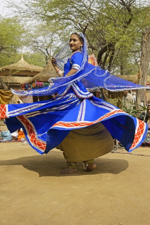 sarujkund: Delhi, India - February 12, 2009: Female Tribal dancer performing at the Sarujkund Fair in Haryana near Delhi, India