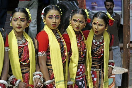 haryana: Delhi, India - February 12, 2009: Group of teenage Indian dancers in traditional tribal outfit at the Sarujkund Craft Fair in Haryana near Delhi, India.