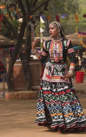kalbelia: Female kalbelia dancer in traditional tribal dress performing at the annual Sarujkund Fair near Delhi, India