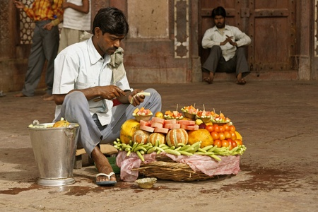 fatehpur: Fatehpur Sikri, India - April 7, 2009: Man selling fresh fruit outside the Friday Mosque in Fatehpur Sikri, Uttar Pradesh, India. Editorial