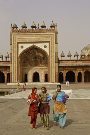 salwar: Fatehpur Sikri, India - April 7, 2009: Group of Indian woman in traditional outfits in the courtyard of the Friday Mosque in Fatehpur Sikri, Uttar Pradesh, India. Editorial