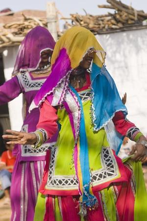 kalbelia: Jaipur, India - March 9, 2009: Tribal dancers in colorful costume performing in Jaipur, Rajasthan, India