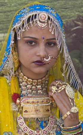 Jaisalmer, Rajasthan, India - January 31, 2007: Teenager in traditional costume at the annual Desert Festival in Jaisalmer, Rajasthan, India Stock Photo - 8505451