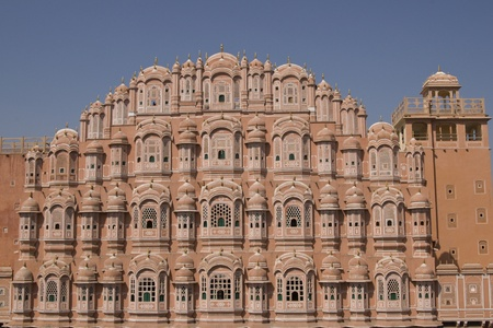 jaipur: Hawa Mahal or Palace of the Winds. Ornate pink facade built to allow ladies of the Royal Court to look into the street without being seen. Jaipur, Rajasthan, India