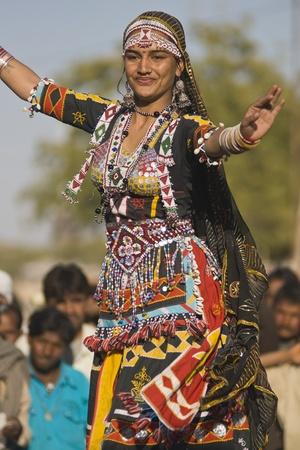 Nagaur, Rajasthan, India - February 15, 2008: Traditional Rajasthani dancer performing at the Nagaur Cattle Fair, Rajasthan, India