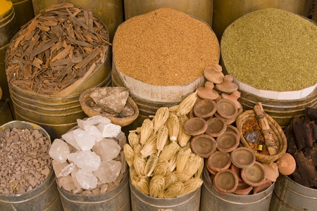 Containers of herbs and spices for sale in a shop in the historic heart of Marrakesh, Morocco photo