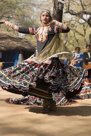 Delhi, India - February 11, 2008: Indian lady dancing at the annual Sarujkund Fair near Delhi, India