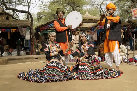 sarujkund: Delhi, India - February 12, 2009: Tribal dancers and musicians at the Sarujkund Fair near Delhi, India Editorial