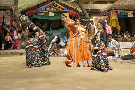 kalbelia: Delhi, India - February 13, 2009: Tribal dancers at the Sarujkund Fair near Delhi, India