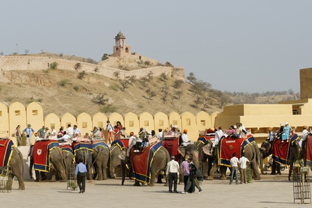 Jaipur, India - March 10, 2009: Tourists dismount from elephants in the courtyard of Amber Fort in Jaipur, India. Stock Photo - 8607907