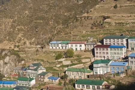 staging: Tibetan style houses in the village of Namche Bazar at an altitude of 3440M in the Nepalese Himalayas. A major staging post for those trekking to Everest Base Camp and beyond.