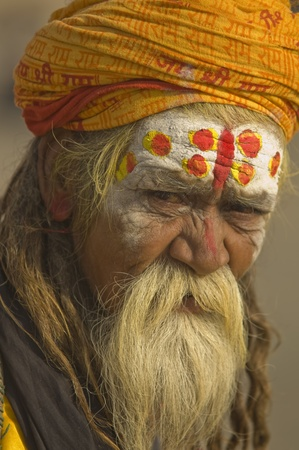 pradesh: Varanasi, Uttar Pradesh, India - October 19, 2007: Hindu Sadhu. Man with beard and painted face in the sacred city of Varanasi, Uttar Pradesh, India