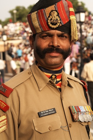 Wagah, Punjab, India - April 21, 2007: Imposing Indian soldier with bushy mustache in dress uniform. Wagah Boarder Post between India and Pakistan