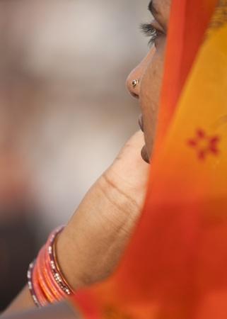 wagah: Wagah, Punjab, India - July 24, 2008:  Indian lady in an orange sari. Wagah, Punjab, India Editorial