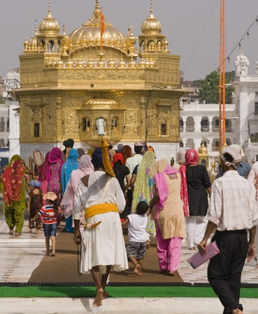 Amritsar, Punjab, India - July 24, 2008: Group of people entering the compound containing the Golden Temple in Amritsar, Punjab, India. Stock Photo - 8644722