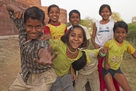 Agra, India - April 7, 2009: Group of boisterous Indian children pose for photograph in Agra, Uttar Pradesh, India.
