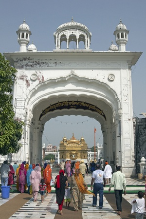 amritsar: Amritsar, Punjab, India - July 24, 2008: Group of people entering the compound containing the Golden Temple in Amritsar, Punjab, India. Editorial
