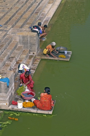 Chittaugarh, India - November 14, 2007: Indian women washing clothes in a lake in Chittaugarh, Rajasthan, India.
