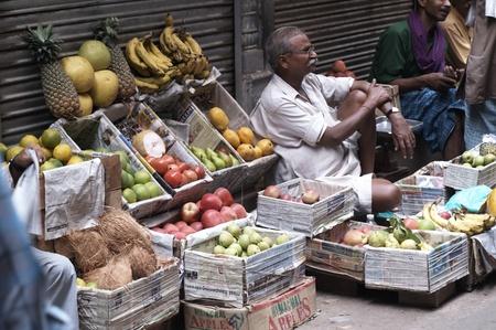 Delhi, India - September 20, 2006: Man selling fruit and vegetables on the street in Old Delhi, India