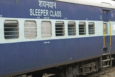Delhi, India - July 18, 2008: Sleeper carriage (3rd class) of Indian Railways. Bars across open windows. Delhi, India.