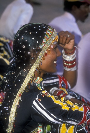 Jodhpur, India - October 5, 2006: Beautiful Kalbelia dancer in ornate black costume trimmed with beads and sequins at the annual Marwar festival in Jodhpur, Rajasthan, India Stock Photo - 8644740